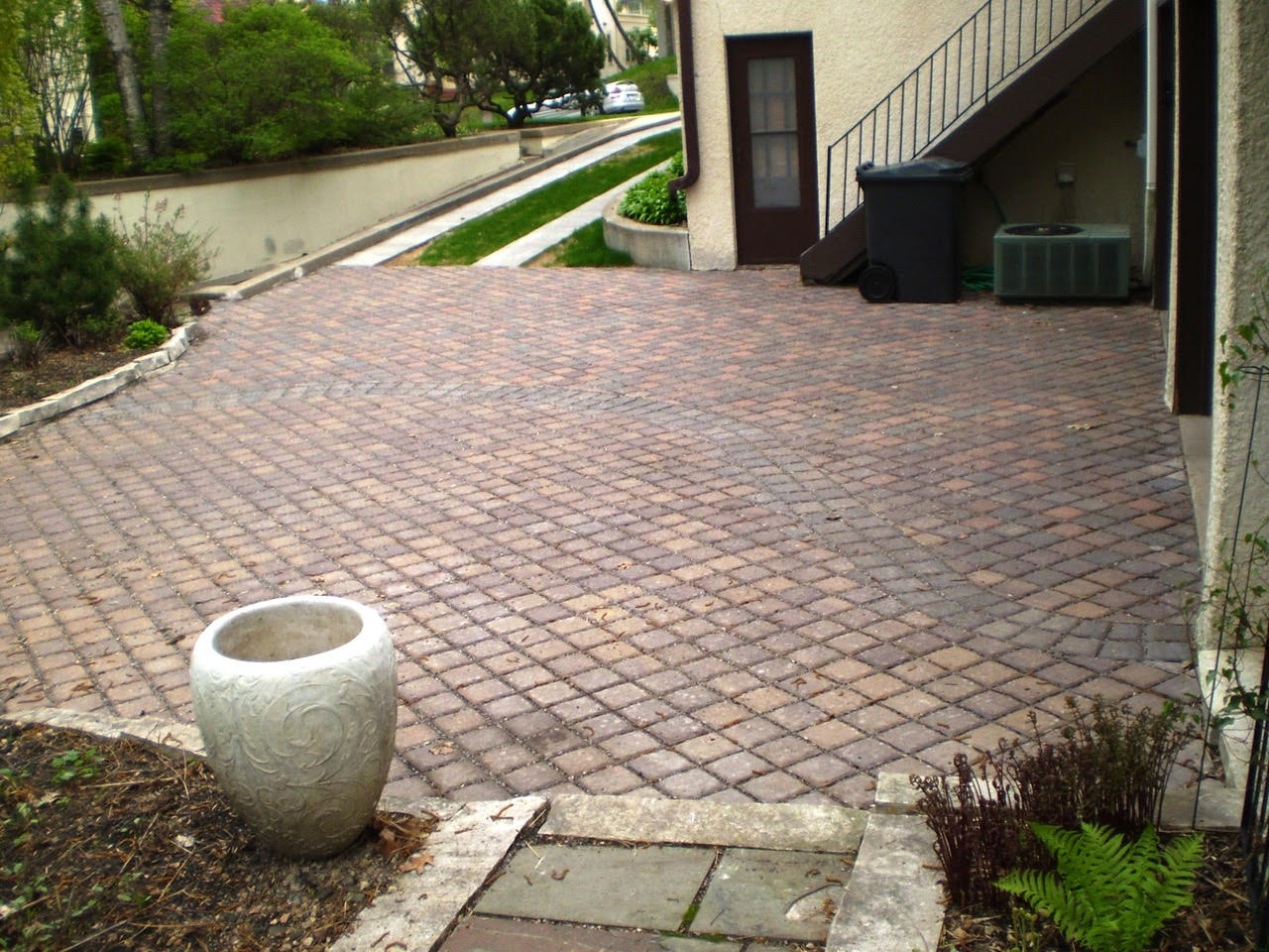 A driveway with a permeable paver pad. Concrete runners allow cars and SUV's alike to maneuver properly.